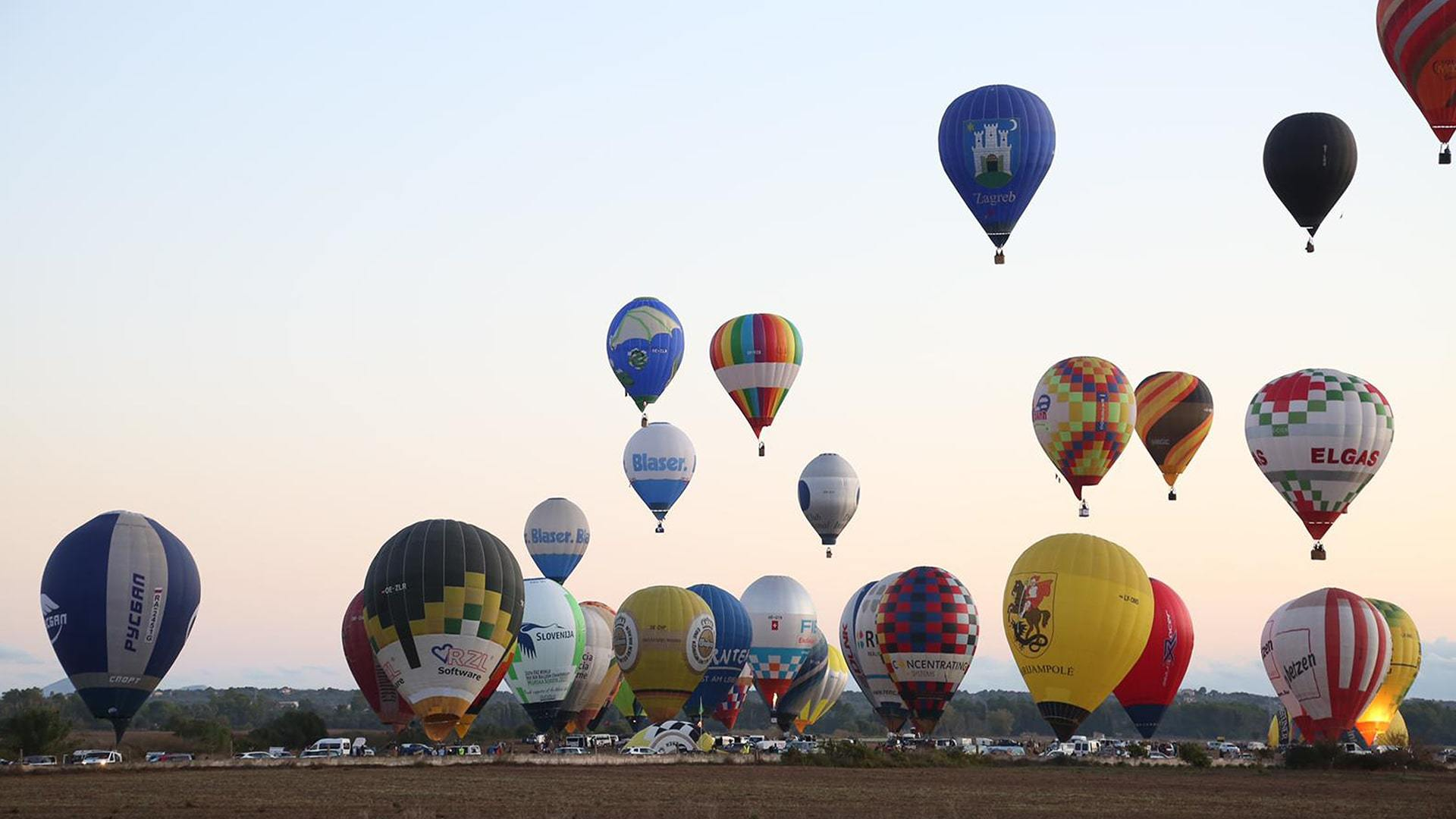 Balloons taking off from Malllorca field during the championships min