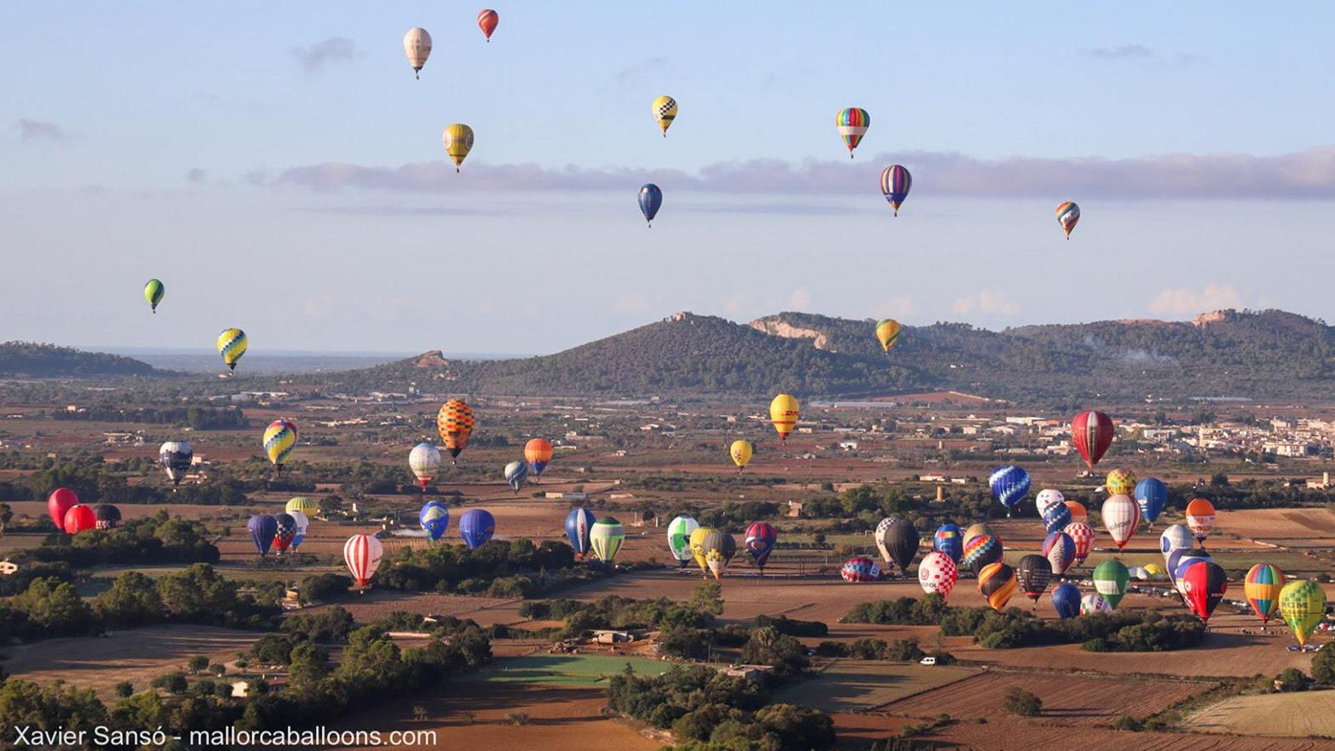 Hot air balloons flying over mallorca countryside min