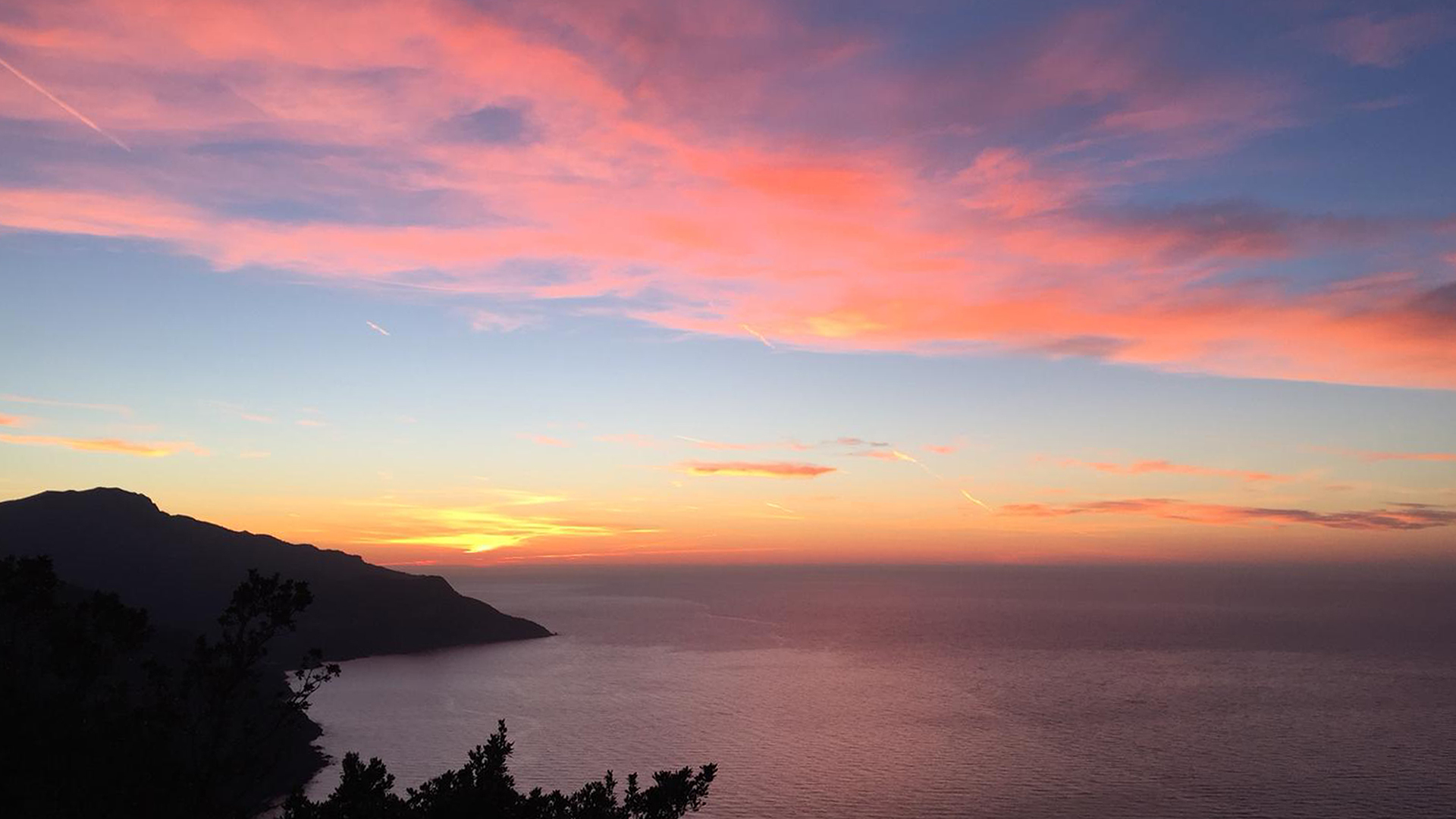 Pink sunset sea mountains view