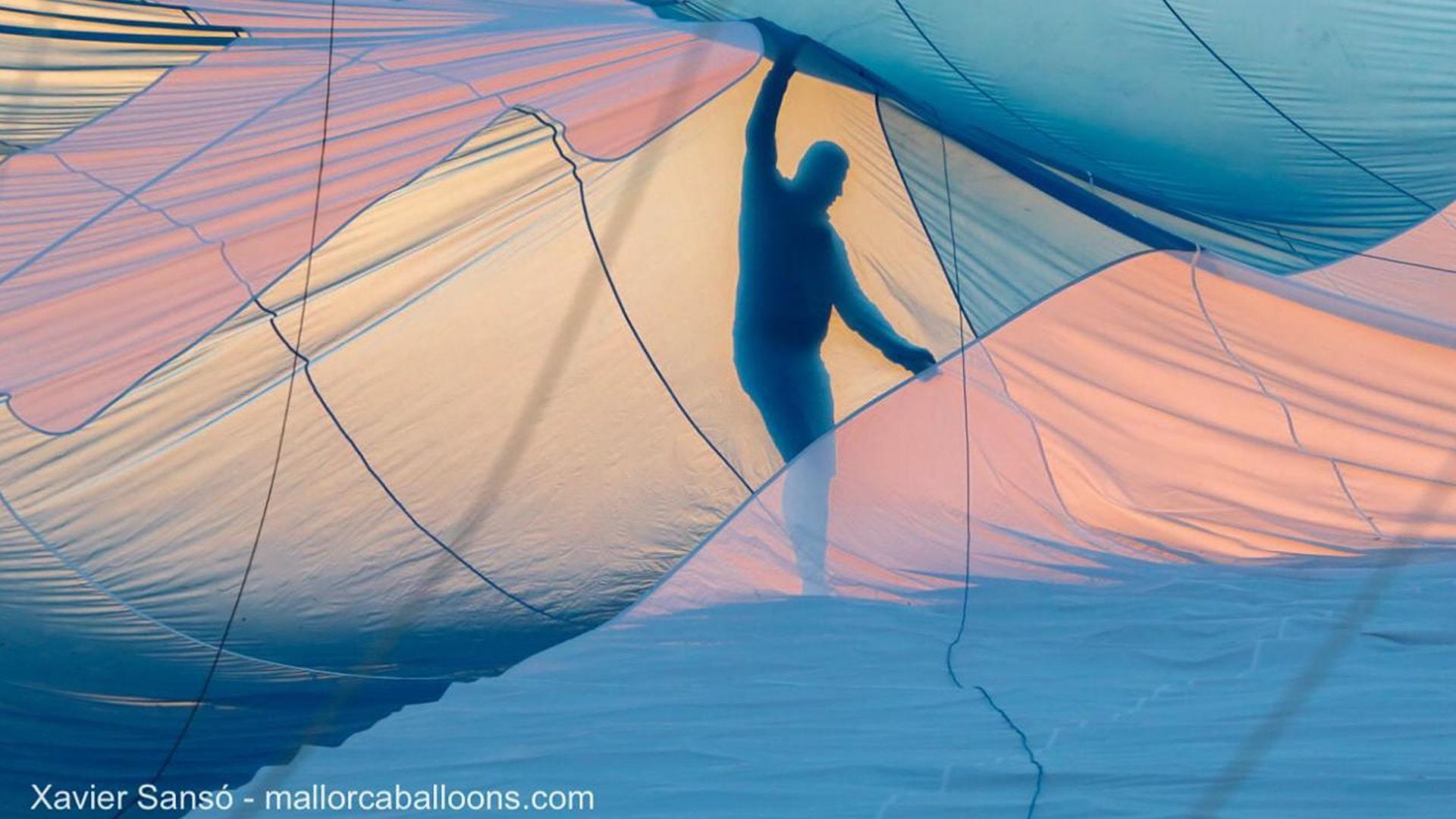 Silhouette man in hot air balloon mallorca hot air balloons european chamipionships min