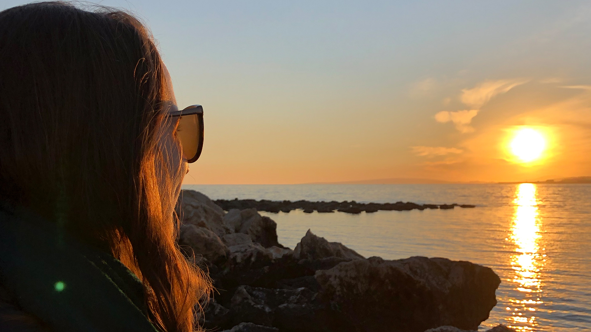 Woman watching sunset portixol Adele Chretien